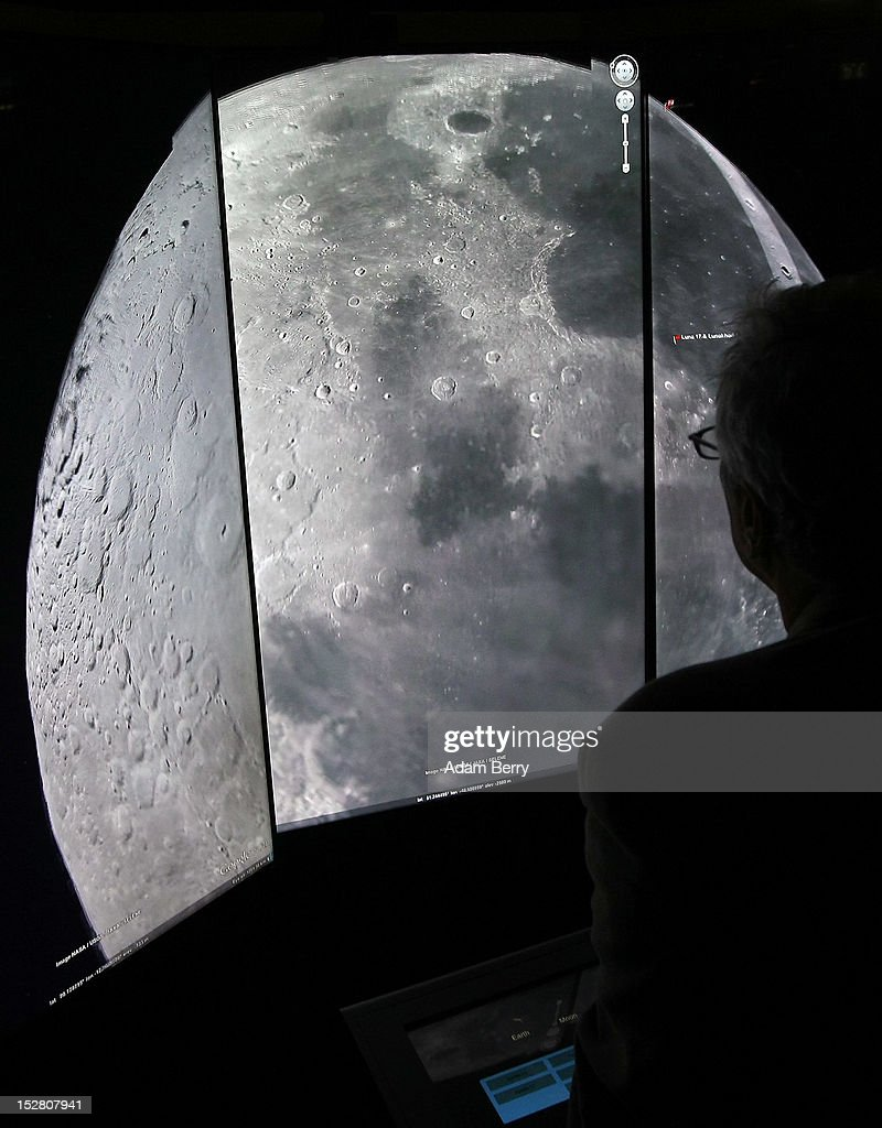 A visitor looks at a three-dimensional rendering of the moon while using Google Earth software on September 26, 2012 at the official opening party of the Google offices in Berlin, Germany. Although the American company holds 95% of the German search engine market share and already has offices in Hamburg and Munich, its new offices on the prestigious Unter den Linden avenue are its first in the German capital. The Internet giant has been met with opposition in the country recently by the former president's wife, who has sued it based on search results for her name that she considers derogative. The European Commission has planned new data privacy regulations in a country where many residents opted in to have their homes pixeled out when the company introduced its Street View technology.