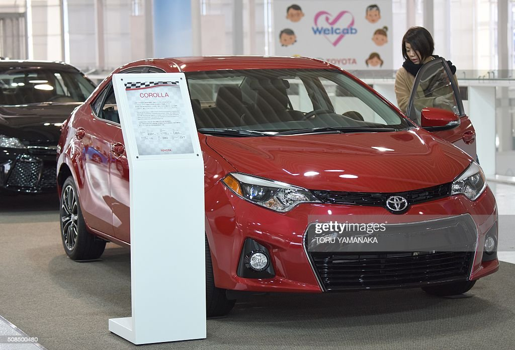 A visitor looks at a Toyota Motor vehicle at a company showroom in Tokyo on February 5 2016 Toyota on February 5 said ninemonth net profit jumped...
