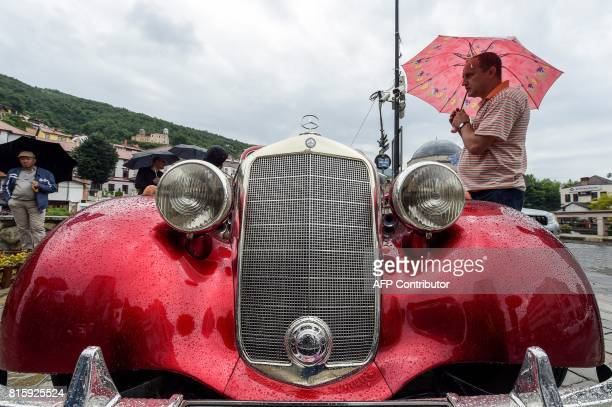 A visitor looks at a vintage Mercedes displayed during the 12th Old Timer Fest on July 17 2017 in the historic city of Prizren in southern Kosovo /...