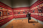 A visitor looks at a wall hanging during the press preview of 'The Fabric of India' at the Victoria and Albert Museum on September 30 2015 in London...