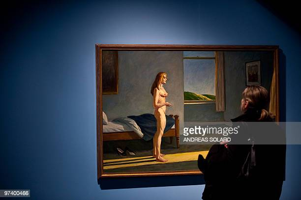 A visitor looks at 'A Woman in the Sun' painting by US artist Edward Hopper on February 24 2010 during the first opening of exhibition running from...