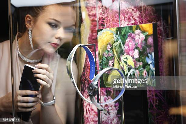 A visitor looks at a wristwatch at the Credor watch stand at the Baselworld watch and jewellry Fair trade on March 17 2016 in Basel SwitzerlandHeld...