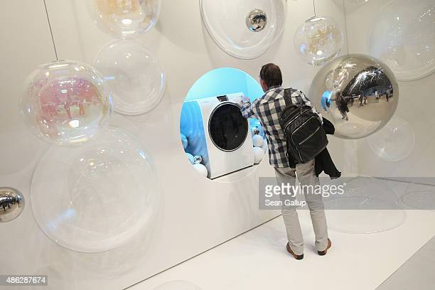 A visitor looks at a WW9000 EcoBubble washing machine at the Samsung stand during a press day at the 2015 IFA consumer electronics and appliances...