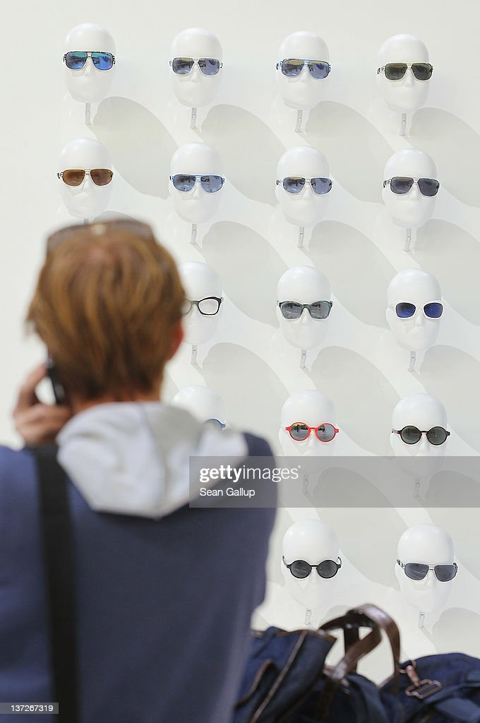 A visitor looks at adidas Originals Eyewear, part of the adidas Originals Fall/Winter 2012 collection, on display at the adidas Originals stand at the Bread and Butter 2012 fashion trade fair on January 18, 2012 in Berlin, Germany.