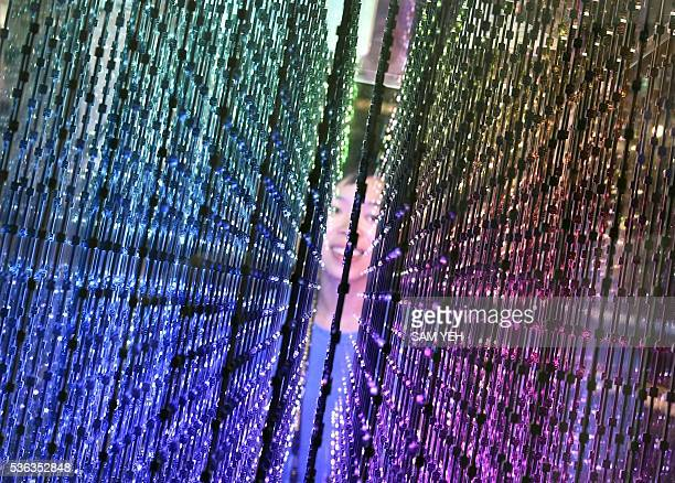 A visitor looks at an array of LED lights during the annual Computex computer show in Taipei on June 1 2016 More than 5000 booth participants from...