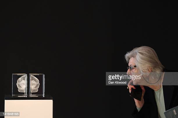A visitor looks at an artwork entitled 'My Soul' by Katharine Dowson which consists of a laser etched lead chrystal glass formation in the shape of a...