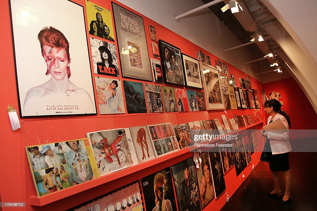 A visitor looks at an installation with record covers and newspapers during the GLAM-Exhibition at Schirn Kunsthalle on June 13, 2013 in Frankfurt am Main, Germany.