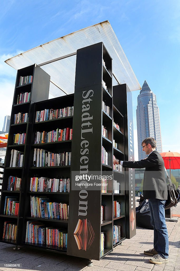 A visitor looks at an outside book stand at the Frankfurt Book Fair on October 10, 2012 in Frankfurt, Germany. The Frankfurt Book Fair is the largest in the world and will run from October 10-14, 2012.