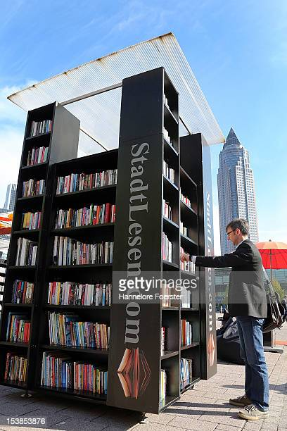 A visitor looks at an outside book stand at the Frankfurt Book Fair on October 10 2012 in Frankfurt Germany The Frankfurt Book Fair is the largest in...