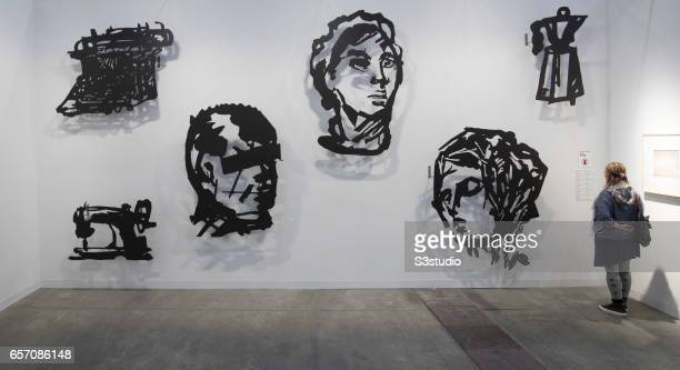 A visitor looks at artist William Kentridge's artworks during Art Basel Hong Kong 2017 at Hong Kong Convention and Exhibition Centre on March 23 2017...