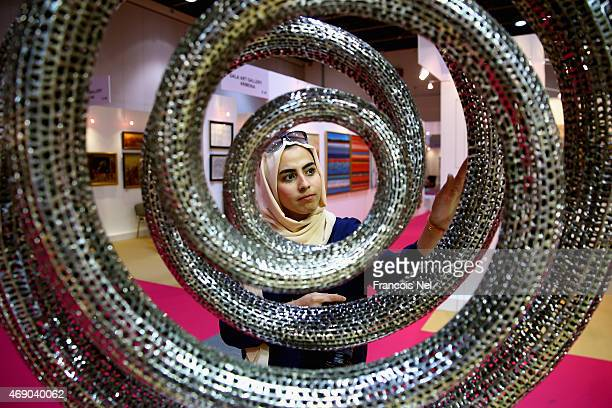 A visitor looks at artwork by artist Marchel Huisman during World Art Dubai 2015 at Dubai World Trade Centre on April 9 2015 in Dubai United Arab...