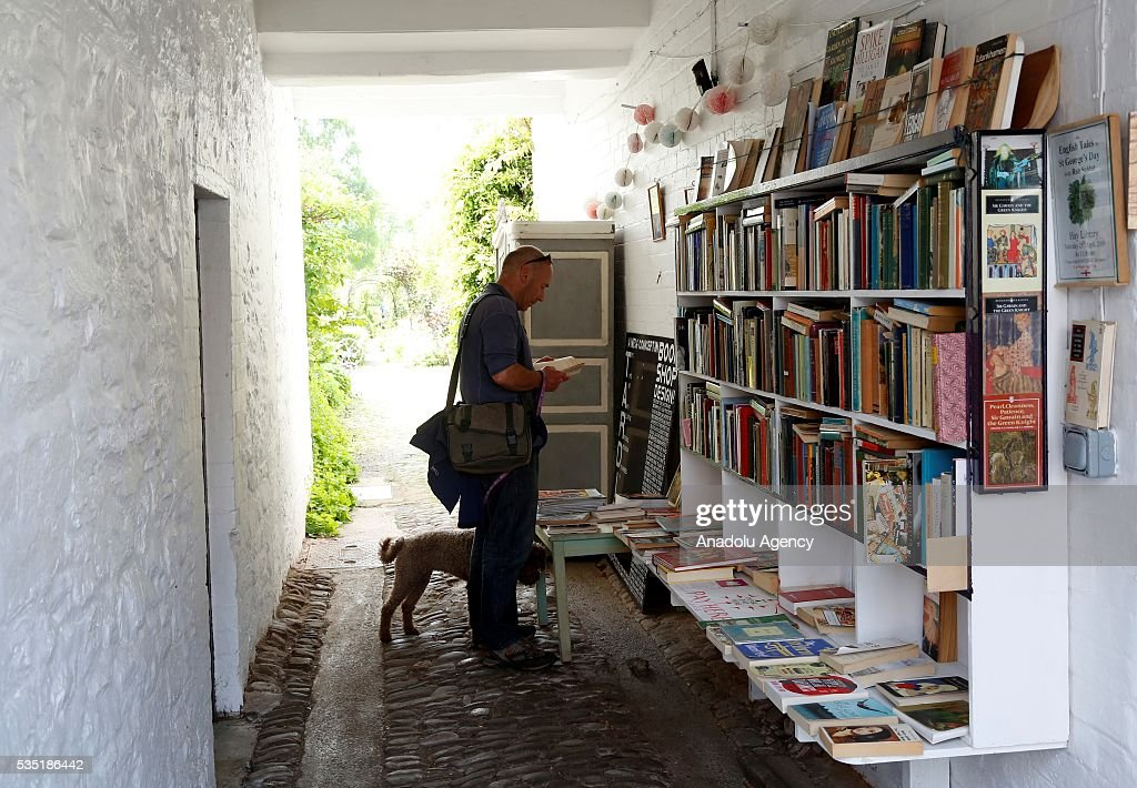 A visitor looks at books during the Hay Festival on May 29, 2016 in Hay-on-Wye, Wales. The Hay Festival is an annual festival of literature and arts now in its 29th year.