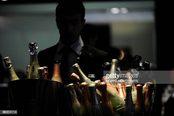 A visitor looks at bottles of Italian 'Spumante' sparkling wine on the first day of the 44th Vinitaly wine fair in Verona on April 8 2010 150000...