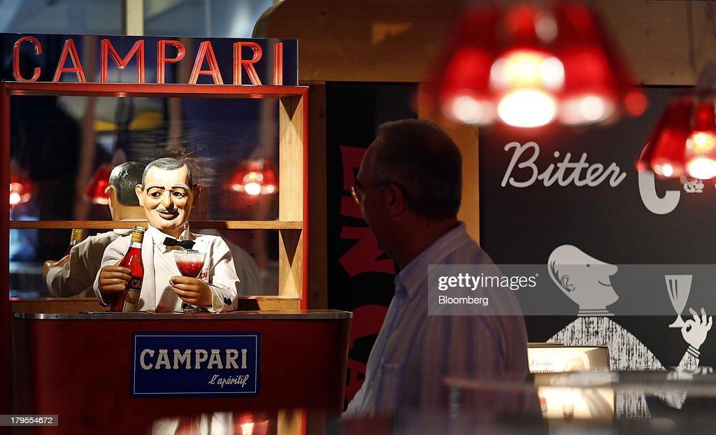 A visitor looks at Campari branded memorabilia inside a gallery at the headquarters of Davide Campari-Milano SpA in Milan, Italy, on Wednesday, Sept. 4, 2013. Campari, the maker of Skyy vodka and Wild Turkey bourbon, said it expects gradual improvement for the rest of the year after sales trends improved for its leading liquor brands in the second quarter. Photographer: Alessia Pierdomenico/Bloomberg via Getty Images