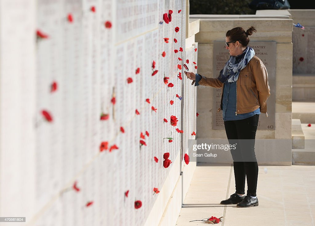 A visitor looks at commemorative poppies and the names of Australian soldiers killed during the Gallipoli Campaign at the Lone Pine monument ahead of...