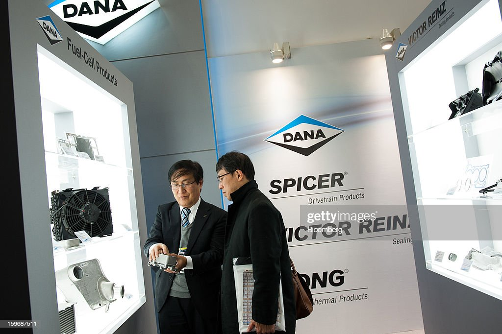 A visitor looks at Dana Ltd. fuel cell products at Automotive World 2013 in Tokyo, Japan, on Friday, Jan. 18, 2013. The Automotive World 2013 trade show ends today. Photographer: Noriko Hayashi/Bloomberg via Getty Images