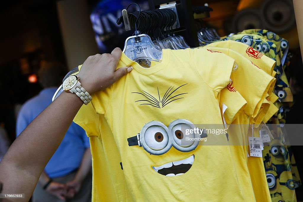 A visitor looks at Despicable Me merchandise for sale in the Studio Store at the Universal Studios Hollywood theme park in Hollywood, California, U.S., on Thursday, Aug. 15, 2013. NBC Universal, majority owned by Comcast Corp., operates some of the most-watched U.S. cable TV channels, in addition to its flagship broadcast network, a film studio and the Universal Studios amusement parks. Photographer: Patrick T. Fallon/Bloomberg via Getty Images