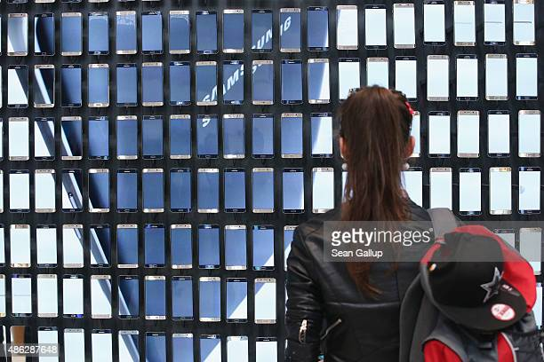A visitor looks at display of Galaxy S6 Edge smartphones at the Samsung stand during a press day at the 2015 IFA consumer electronics and appliances...