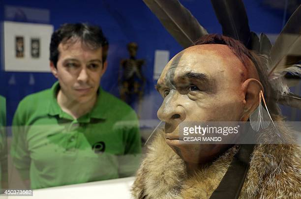 A visitor looks at 'El Neandertal Emplumado' a scientificly based impression of the face of a Neanderthal who lived some 50000 years ago by Italian...