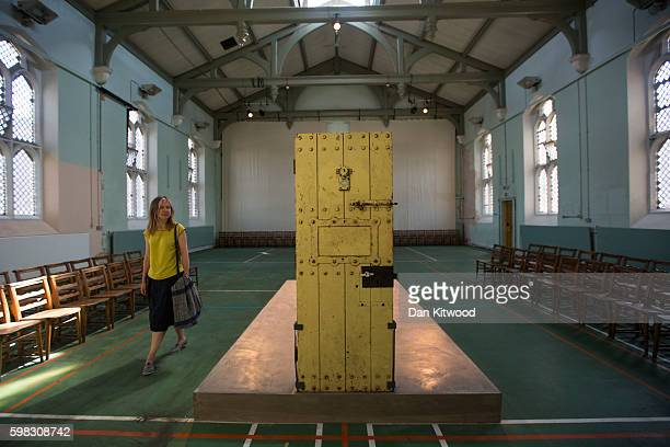 A visitor looks at former inmate Oscar Wilde's prison cell door on display in the prison Chapel on September 1 2016 in Reading England The former...