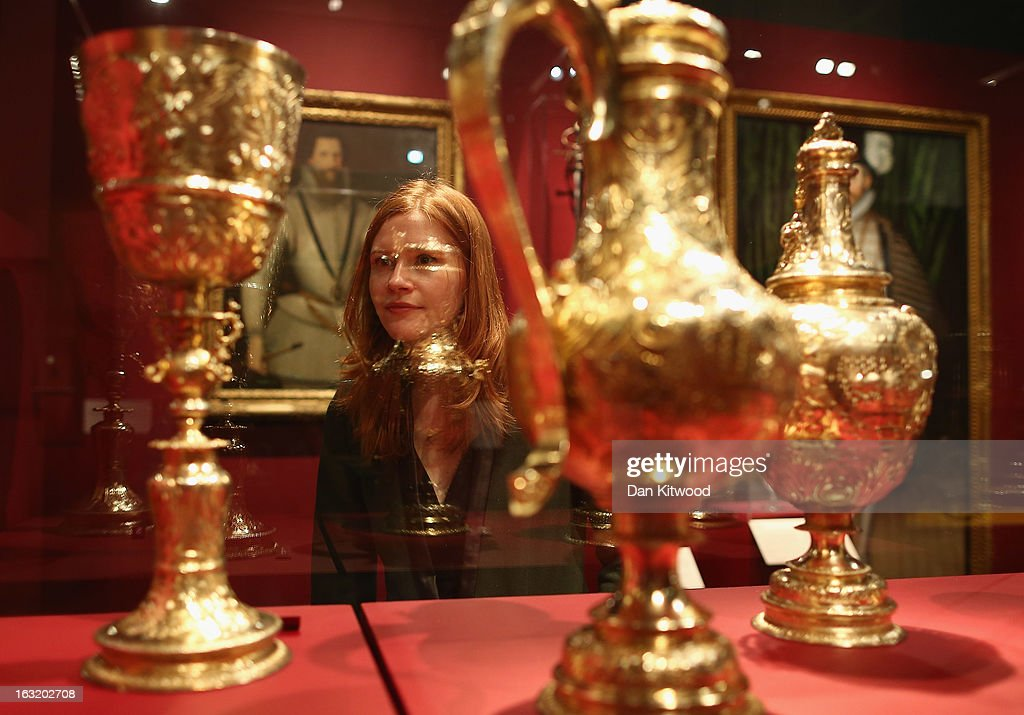 A visitor looks at gold pots, which form part of the historic collection of armoury during a press preview of the V&A's new exhibit on March 6, 2013 in London, England. The exhibition, 'Treasures of the Royal Court: Tudors, Stuarts and the Russian Tsars' examines the development of cultural diplomacy and trade between Britain and Russia from it's origins in 1555. The runs at the V&A museum until July 14, 2013.