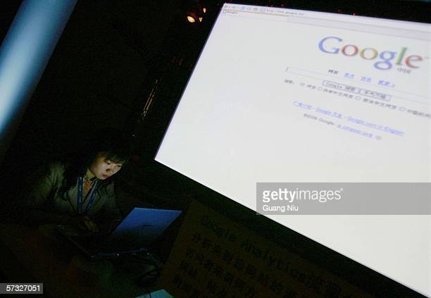 A visitor looks at Google website in a laptop during Google global Chinese name launch ceremony April 12 2006 in Beijing China Google said it has...