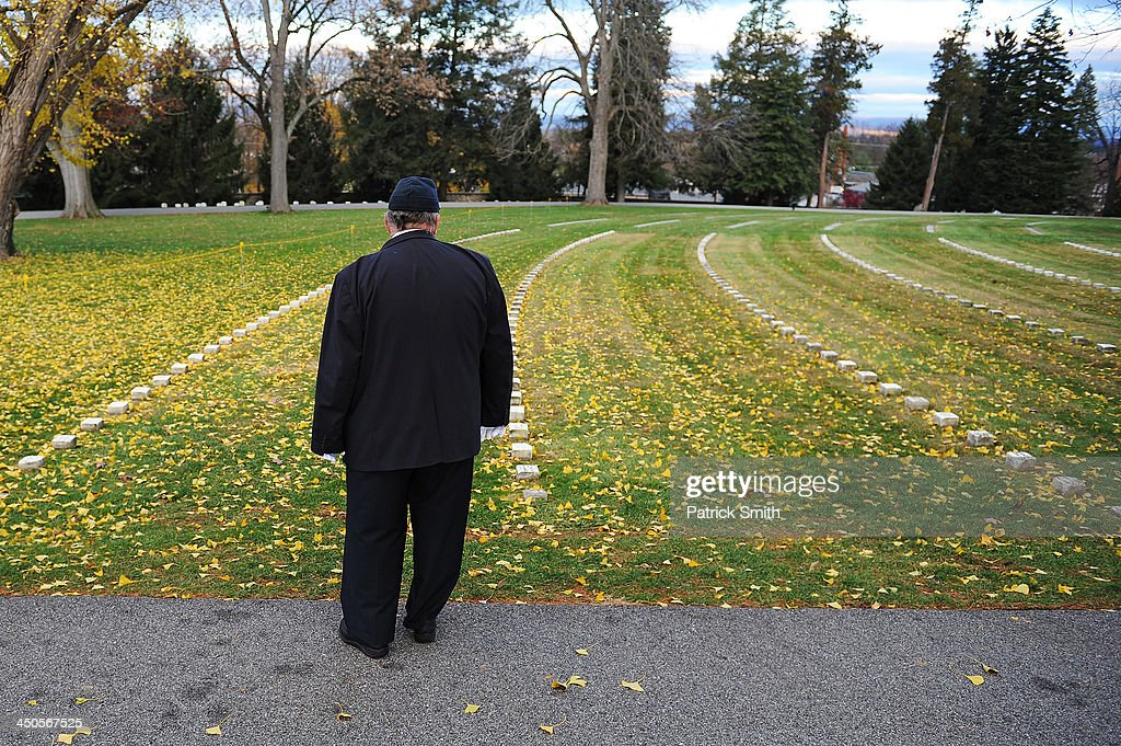 A visitor looks at grave markers prior to a commemoration of the 150th Anniversary of the Gettysburg Address at the Soldiers' National Cemetery at Gettysburg National Military Park on November 19, 2013 in Gettysburg, Pennsylvania. The iconic Gettysburg Address was given by U.S. President Abraham Lincoln in 1863 during the Civil War and highlighted the principles of democracy, human equality, and freedom and professed that 'government of the people, by the people, for the people, shall not perish from the earth.'.