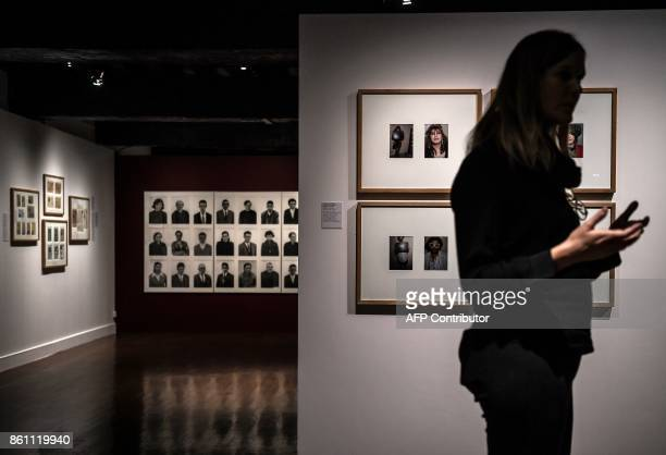 A visitor looks at images that are part of the 'Papiers s'il vous plaît' photo exhibition at the photography at the Nicephore Niepce Museum in...