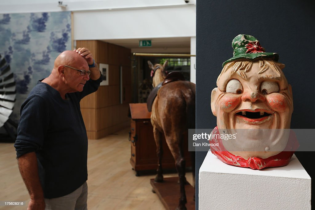 A visitor looks at items during a press preview at Christie's Auction House on August 5, 2013 in London, England. The 'Out of the Ordinary' sale at Christie's Auction House, takes place on September 5, 2013.