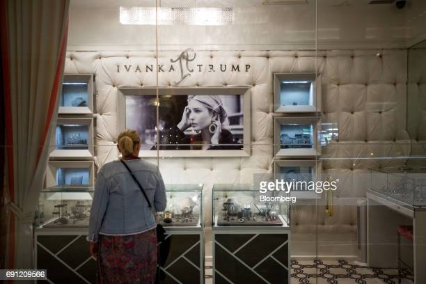 A visitor looks at jewelry displayed in the window of the Ivanka Trump Collection store at Trump Tower in New York US on Thursday June 1 2017 Two...