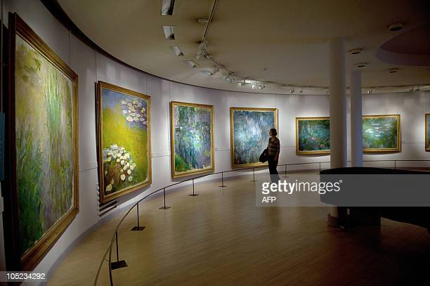 A visitor looks at Nympheas series by French artist Claude Monet at the Marmottan museum on October 7 2010 as part of an exhibition dedicated to the...