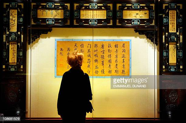 A visitor looks at objects during a preview of 'The Emperor's Private Paradise Treasures from the Forbidden City' exhibition at the Metropolitan...