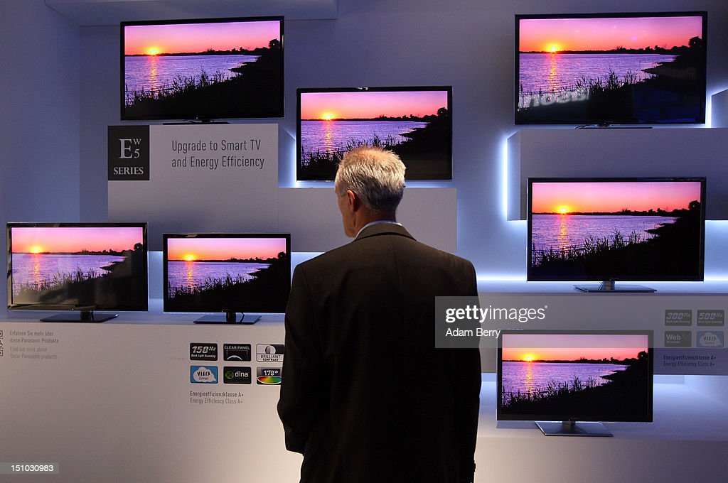 A visitor looks at Panasonic ETW5 energy efficient Smart TV flat-screen televisions at the Internationale Funkausstellung (IFA) 2012 consumer electronics trade fair on August 31, 2012 in Berlin, Germany. IFA 2012 is open to the public from today until September 5.