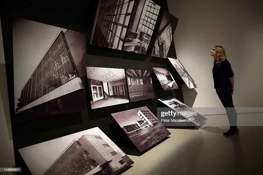 A visitor looks at photographs of the bauhaus building at for Pool design dessau
