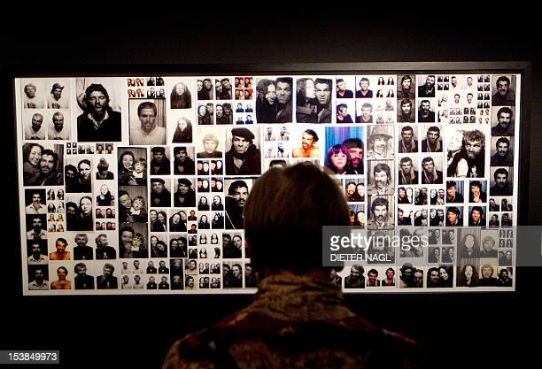 A visitor looks at photos on display during the opening of the exhibition'Photo Booth Art' on October 9 2012 at the 'Kunsthaus' museum in Vienna AFP...