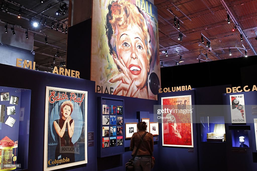 A visitor looks at pictures and posters of the french singer Edith Piaf displayed during the 'PIAF' exhibition at the bibliotheque nationale de France (BNF, French national library) on April 13, 2015 in Paris, France. PIAF exhibition celebrates Edith Piaf's birth centenary.