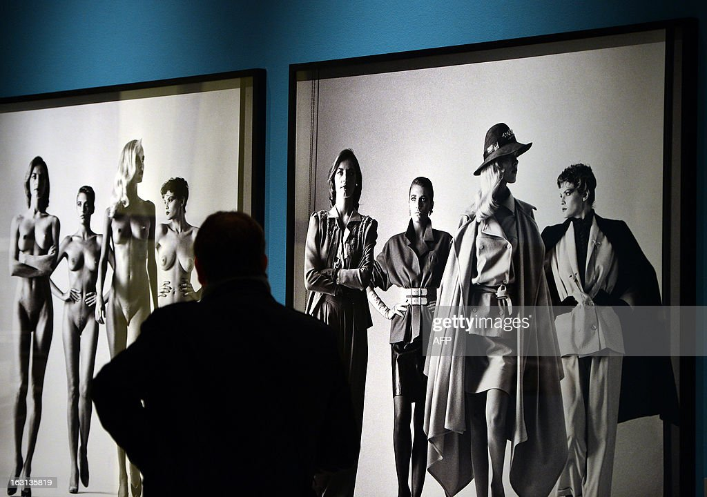 A visitor looks at pictures by German-Australian photographer Helmut Newton during a press preview of the 'White women / Sleepless nights / Big nudes' exhibition at the Palazzo delle Esposizioni on March 5, 2013 in Rome. The exhibition will run from March 6 to July 21, 2013.