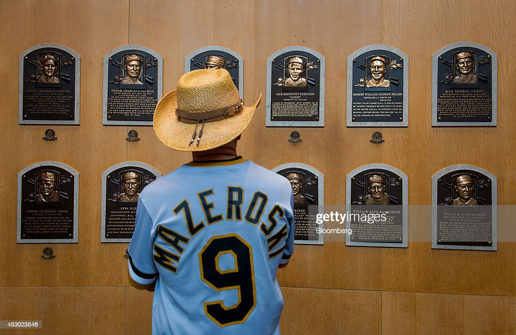 A visitor looks at plaques for players who are members of the National Baseball Hall of Fame and Museum in Cooperstown New York US on Saturday July...