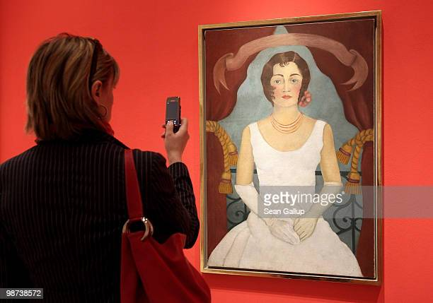 A visitor looks at 'Portrait of a Lady in White' by Mexican painter Frida Kahlo at the Frida Kahlo Retrospective at MartinGropiusBau on April 29 2010...