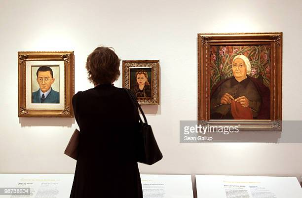 A visitor looks at portraits by Mexican painter Frida Kahlo at the Frida Kahlo Retrospective at MartinGropiusBau on April 29 2010 in Berlin Germany...
