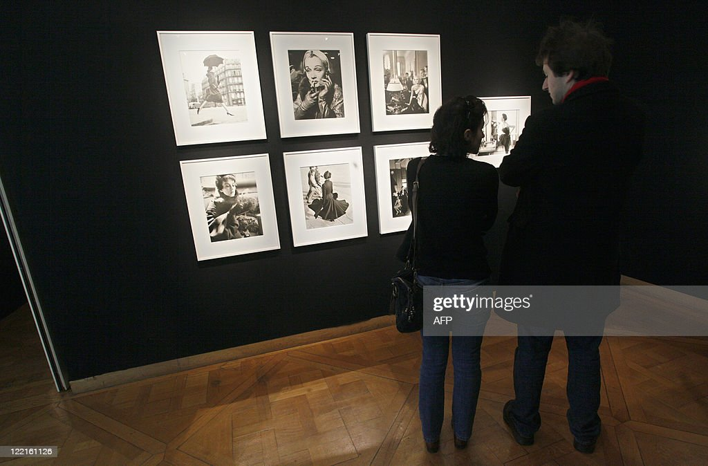 A visitor looks at portraits (one of late German actress Marlene Dietrich at center) by US Richard Avedon displayed at Christie's auction house in Paris, on November 20, 2010, prior to a sale of 65 pictures by the artist, including portraits of US actress Marilyn Monroe and British singers The Beatles.