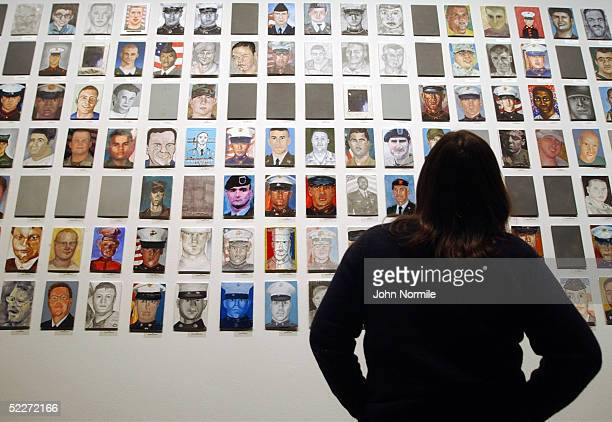 A visitor looks at portraits of US soldiers killed in Iraq on the first day of the exhibition 'To Never Forget The Faces of the Fallen' in the...