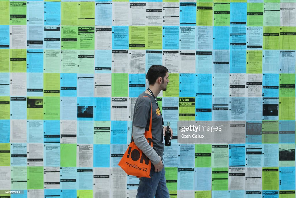 A visitor looks at printouts of the day's tweets during the 2012 re.publica conferences on May 2, 2012 in Berlin, Germany. The re:publica conferences bring bloggers, hackers and activists together for conferences whose themes involve digital society.