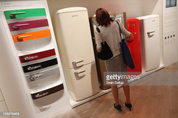 A visitor looks at retrodesign refrigerators at the Gorenje stand at the IFA 2011 consumer electonics and appliances trade fair on the first day of...