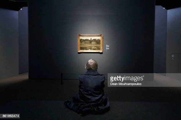 A visitor looks at 'Saint Ouen' by Matthijs Maris during a special exhibition held at the Rijksmuseum Exhibition on October 13 2017 in Amsterdam...