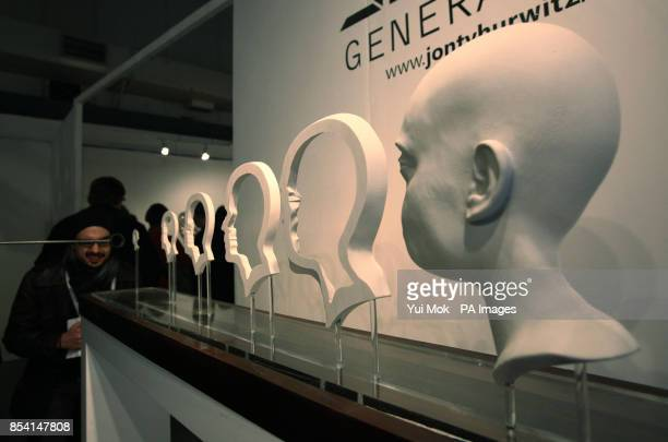 A visitor looks at sculpture 'The Hurwitz Singularity' by artist Jonty Hurwitz at the launch of his series of anamorphic sculptures 'Generation Pi'...
