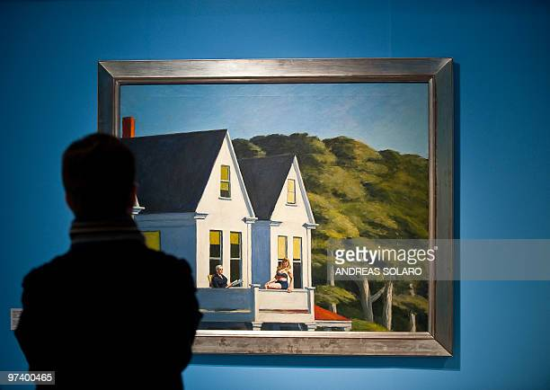 A visitor looks at 'Second Story Sunlight' painting by US artist Edward Hopper on February 24 2010 during the first opening of exhibition running...