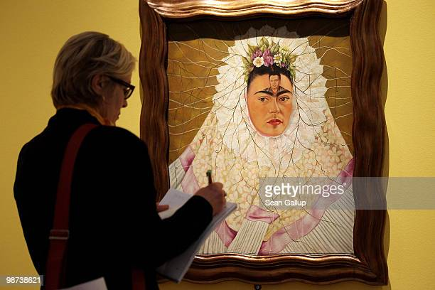 A visitor looks at 'SelfPortrait as Tehuana or Diego on My Mind' by Mexican painter Frida Kahlo at the Frida Kahlo Retrospective at MartinGropiusBau...