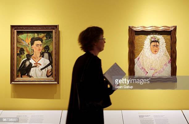 A visitor looks at selfportraits by Mexican painter Frida Kahlo at the Frida Kahlo Retrospective at MartinGropiusBau on April 29 2010 in Berlin...