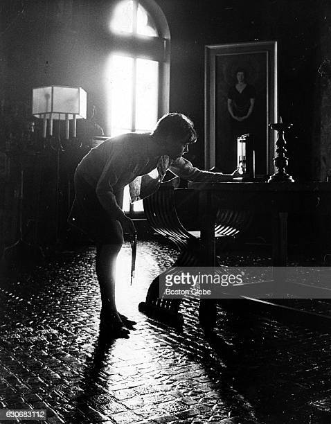 A visitor looks at something in the Gothic Room at the Isabella Stewart Gardner Museum in Boston on Nov 14 1966 A portrait of Mrs Gardner by John...
